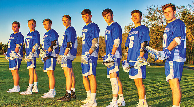 Members Of Wellington High School's Boys Lacrosse Team Leave Their Mark
